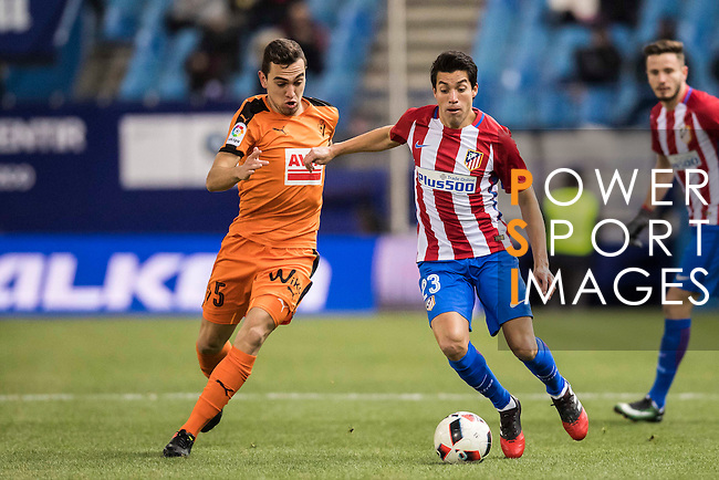Nicolas Gaitan (r) of Atletico de Madrid competes for the ball with Gonzalo Escalante of SD Eibar during their Copa del Rey 2016-17 Quarter-final match between Atletico de Madrid and SD Eibar at the Vicente Calderón Stadium on 19 January 2017 in Madrid, Spain. Photo by Diego Gonzalez Souto / Power Sport Images