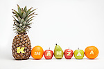 Row of fruits, studio shot