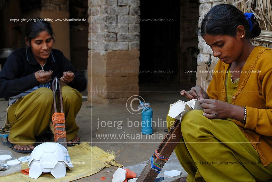 INDIA Uttar Pradesh, Meerut , village Kurali, cottage industry, dalit women stitch football