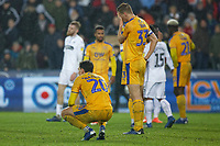 (L-R) Kal Naismith and Dan Burn of Wigan Athletic look dejected after the final whistle during the Sky Bet Championship match between Swansea City and Wigan Athletic at the Liberty Stadium, Swansea, Wales, UK. Saturday 29 December 2018