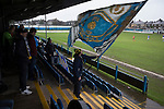 Port Talbot Town 3 Caerau Ely 0, 06/02/2016. Genquip Stadium, Welsh Cup fourth round. A home fan waving a big flag as Port Talbot Town (in blue) play host to Caerau Ely in a Welsh Cup fourth round tie at the Genquip Stadium, formerly known as Victoria Road. Formed by exiled Scots in 1901 as Port Talbot Athletic, they competed in local and regional football before being promoted to the League of Wales  in 2000 and changing their name to the current version a year later. Town won this tie 3-0 against their opponents from the Welsh League, one level below the welsh Premier League where Port Talbot competed, watched by a crowd of 113. Photo by Colin McPherson.