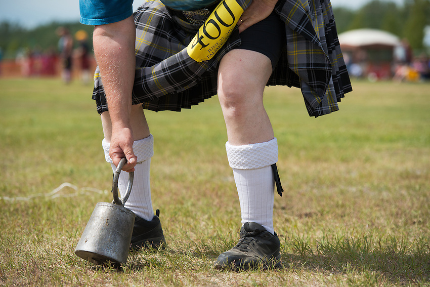 Dave Patterson competes in the weight over height event during the 2015 Alaska Scottish Highland Games at the Palmer fairgrounds.
