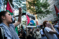 NEW YORK, NY - JUNE 15: A large group of pro-Palestinian protesters wave flags during a large protest alongside the Consulate General of Israel in New York on June 15, 2021. The solidarity action of hundreds of pro-Palestinians is a form of support against attacks carried out by the Israeli government. At the same time, Palestinian Prime Minister Mohammad Shtayyeh says the new Israeli government is just as bad as the old one and condemns Naftali Bennett's announcements in support of Israeli settlements. That is why the demonstrations continue in different parts of the world. (Photo by Pablo Monsalve / VIEWpress via Getty Images