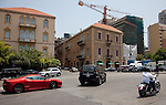 July 2010, LEBANON:  A red Lamborghini sports car and Harley Davidson motorcycle compete for space on the roads of the fashionable Gemmayze district of the re-vitalised Lebanese capital.