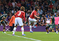 July 31, 2012..Japan's Saki Kumagai (4) and South Africa's Zamandosi Cele (6) in action during Football match between JPN and RSA at the Millennium Stadium on day four of 2012 Olympic Games in Cardiff, United Kingdom...