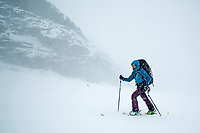 Skitouring in a blizzard conditions, French Alps