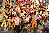 Bali, Indonesia.  Tourists Waiting to see the Kecak Dance, in Arena adjacent to Uluwatu Temple.