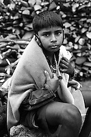 A working kid, waiting to get wood to be sold for funeral pyres.<br /> India, 2012