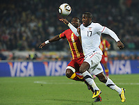 U.S. forward tries to power past Ghana defender John Mensah in route to a shot on goal. Ghana defeated the U.S., 2-1, in extra time to advance to the quarterfinals, Saturday, June 26th, at the 2010 FIFA World Cup in South Africa..