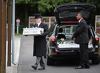 Pictured: The coffin carrying baby Sion is taken inside Briwnant Chapel at Thornhill Cemetery, Cardiff, Wales, UK. Tuesday 28 June 2016<br /> Re: The funeral of Sion, the baby boy found dead in the River Taff in Cardiff has taken place<br /> Generous locals raised nearly £1,400 for the memorial after reading about plans to hold a fitting ceremony for the newborn baby whose body was discovered in Cardiff a year ago.<br /> The funeral took place at the Briwnant Chapel at Thornhill Crematorium, Cardiff. Members of the public are invited to be among the congregation.