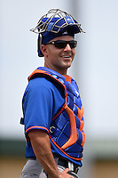 New York Mets bullpen catcher Dave Racaniello (54) during a Spring Training game against the St. Louis Cardinals on April 2, 2015 at Roger Dean Stadium in Jupiter, Florida.  The game ended in a 0-0 tie.  (Mike Janes/Four Seam Images)