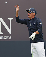 13th July 2021; The Royal St. George's Golf Club, Sandwich, Kent, England; The 149th Open Golf Championship, practice day; Ricky Fowler (USA) catches a ball tossed to him by his caddie on the 1st hole