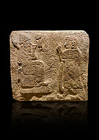 Alaca Hoyuk Sphinx Gate Hittite monumental relief sculpted orthostat stone panel. Andesite, Alaca, Corum, 1399 - 1301 B.C. Anatolian Civilizations Museum, Ankara, Turkey.<br /> <br /> Figure with a sharp and horned headdress (probably a god) sitting on a stool with a short backrest, with a figure (probably the figure of a king) worshipping to it. Both figures wear a large and ring-shaped earring. Among them is a hieroglyph, the symbol of divinity.<br /> <br /> Against a black background.