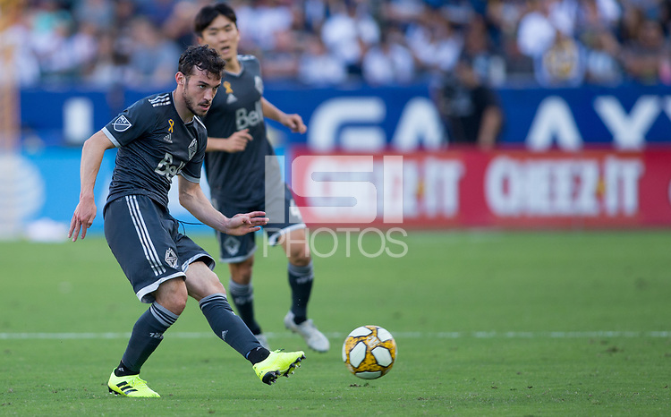 CARSON, CA - SEPTEMBER 29: Russell Teibert #31 of the Vancouver Whitecaps passes off a ball during a game between Vancouver Whitecaps and Los Angeles Galaxy at Dignity Health Sports Park on September 29, 2019 in Carson, California.