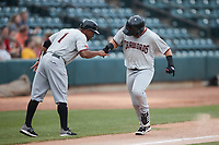 Trey Hair (6) of the Hickory Crawdads is congratulated by third base coach Josh Johnson (1) after hitting a home run against the Winston-Salem Dash at Truist Stadium on July 7, 2021 in Winston-Salem, North Carolina. (Brian Westerholt/Four Seam Images)