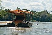 Pará State, Brazil. Xingu River. Illegal gold dredger at work.