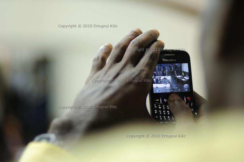 A journalist captures a photoof Desi Bouterse (Desiré Delano Bouterse)  with his mobile device during presidential elections at De Nationale Assemblée (DNA) / The National Assemble of Suriname....Desi Bouterse (Desiré Delano Bouterse) chosen as new president of Suriname by De Nationale Assemblée (DNA) / The National Assemble of Suriname. He took 36 votes of 51 as leader of the Mega Combination. ....Robert_Ameerali the head of KKF (Kamer van Koophandel en Fabrieken) / Chamber of Commerce and Industry also selected as Vice President.....Desi Bouterse (Desiré Delano Bouterse) will sworn at 3 August 2010