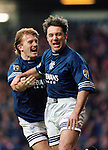 1996, ALLY MCCOIST CELEBRATES SCORING A GOAL WITH TEAM-MATE STUART MCCALL, ROB CASEY PHOTOGRAPHY.