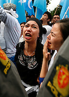 Muslim Uighurs protest in front of the Chinese Embassy in the Norwegian capital Oslo. The protests followed unrest in China's western region of Xinjiang. One protester sustained minor injuries, one was taken away by ambulance, and some were detained by Norwegian police following the protest...© Fredrik Naumann/Felix Features