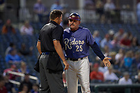 Frisco RoughRiders manager Joe Mikulik (25) argues a call with umpire Andy Stukel during a Texas League game against the Springfield Cardinals on May 7, 2019 at Dr Pepper Ballpark in Frisco, Texas.  (Mike Augustin/Four Seam Images)