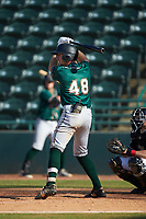 Justin Harrer (48) of the Greensboro Grasshoppers at bat against the Hickory Crawdads at L.P. Frans Stadium on May 26, 2019 in Hickory, North Carolina. The Crawdads defeated the Grasshoppers 10-8. (Brian Westerholt/Four Seam Images)
