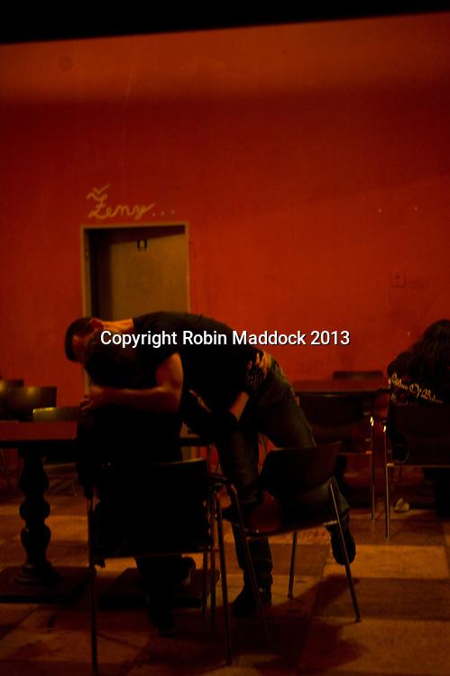couple kissing at a satanic rock gig in Brno