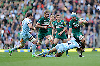 Jordan Crane of Leicester Tigers is tackled by Courtney Lawes of Northampton Saints during the Aviva Premiership Final between Leicester Tigers and Northampton Saints at Twickenham Stadium on Saturday 25th May 2013 (Photo by Rob Munro)