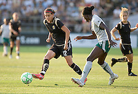 Christine Sinclair (12) passes the ball to a teammate, defended by Tina Ellertson (8). FC Gold Pride tied the St. Louis Athletica 1-1 at Buck Shaw Stadium in Santa Clara, California on August 9, 2009.