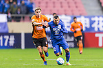 Carlos Tevez (r) of Shanghai Shenhua FC competes for the ball with Thomas Kristensen of Brisbane Roar during their AFC Champions League 2017 Playoff Stage match between Shanghai Shenhua FC (CHN) and Brisbane Roar (AUS) at the Hongkou Stadium, on 08 February 2017 in Shanghai, China. Photo by Marcio Rodrigo Machado / Power Sport Images