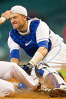 Catcher Michael Williams #35 of the Kentucky Wildcats tags out a runner at home plate against the Houston Cougars at Minute Maid Park on March 5, 2011 in Houston, Texas.  Photo by Brian Westerholt / Four Seam Images