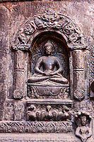 Nepal, Patan.  Buddha in the Dhyana Mudra Position, Symbolizing Meditation.  Entrance to the Golden Temple (Kwa Baha), a Buddhist Shrine.