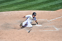 Alex Yarbrough (9) of the Salt Lake Bees slides home safe against the El Paso Chihuahuas in Pacific Coast League action at Smith's Ballpark on July 26, 2015 in Salt Lake City, Utah. El Paso defeated Salt Lake 6-3 in 10 innings.(Stephen Smith/Four Seam Images)