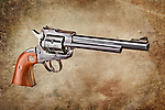 Gun photo: Revolver outlined and placed on background.