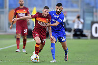 Jordan Veretout of AS Roma and Rachid Ghezzal of ACF Fiorentina compete for the ball during the Serie A football match between AS Roma and ACF Fiorentina at stadio Olimpico in Roma (Italy), July 26th, 2020. Play resumes behind closed doors following the outbreak of the coronavirus disease. <br /> Photo Antonietta Baldassarre / Insidefoto