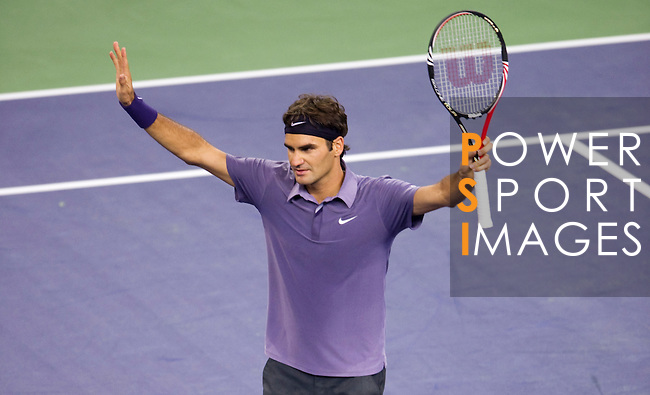 SHANGHAI, CHINA - OCTOBER 13:  Roger Federer of Switzerland celebrates match point to John Isner of USA during day three of the 2010 Shanghai Rolex Masters at the Shanghai Qi Zhong Tennis Center on October 13, 2010 in Shanghai, China.  (Photo by Victor Fraile/The Power of Sport Images) *** Local Caption *** Roger Federer