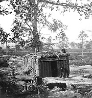 """Bomb-proof Restaurant on the Petersburg Line.  Who but a """"Yank"""" would think of starting a """"store"""" or restaurant on the line of battle where shot and shell are constantly falling?  Ca.  1864-65.  Stereo.  (National Archives Gift Collection)<br /> Exact Date Shot Unknown<br /> NARA FILE #:  200-CC-1051<br /> WAR & CONFLICT BOOK #:  222"""
