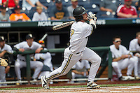 Vanderbilt Commodores shortstop Dansby Swanson (7) follows through on his swing during the NCAA College baseball World Series against the Cal State Fullerton Titans on June 15, 2015 at TD Ameritrade Park in Omaha, Nebraska. Vanderbilt beat Cal State Fullerton 4-3. (Andrew Woolley/Four Seam Images)