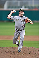 Starting pitcher John Caskey (12) of the Wofford College Terriers delivers a pitch in a game against the Clemson University Tigers on Tuesday, March 1, 2016, at Doug Kingsmore Stadium in Clemson, South Carolina. Clemson won, 7-0. (Tom Priddy/Four Seam Images)