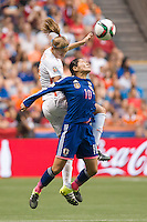 June 23, 2015: Homare SAWA of Japan protects the ball during a round of 16 match between Japan and Netherlands at the FIFA Women's World Cup Canada 2015 at BC Place Stadium on 23 June 2015 in Vancouver, Canada. Japan won 2-1. Sydney Low/AsteriskImages.com