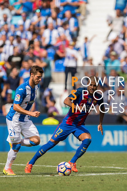 Rafinha of FC Barcelona battles for the ball with Ruben Perez of Deportivo Leganes during their La Liga match between Deportivo Leganes and FC Barcelona at the Butarque Municipal Stadium on 17 September 2016 in Madrid, Spain. Photo by Diego Gonzalez Souto / Power Sport Images