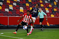 7th November 2020; Brentford Community Stadium, London, England; English Football League Championship Football, Brentford FC versus Middlesbrough; Rico Henry of Brentford blocking the ball from Djed Spence of Middlesbrough
