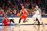 NEW YORK, NY - Sunday December 13, 2015: Michael Gbinije (#0) of Syracuse  dribbles past half-court.  St. John's defeats Syracuse 84-72 during the NCAA men's basketball regular season at Madison Square Garden in New York City.