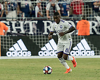FOXBOROUGH, MA - JULY 28: Sebastian Mendez #8 dribbles during a game between Orlando City SC and New England Revolution at Gillette Stadium on July 27, 2019 in Foxborough, Massachusetts.