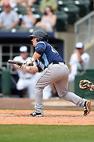 Corpus Christi Hooks designated hitter Tyler Heineman (12) looks to bunt during a game against the NW Arkansas Naturals on May 26, 2014 at Arvest Ballpark in Springdale, Arkansas.  NW Arkansas defeated Corpus Christi 5-3.  (Mike Janes/Four Seam Images)