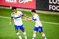 LOS ANGELES, CA - SEPTEMBER 02: Danny Hoesen #9 and Cristian Espinoza #10 of the San Jose Earthquakes congratulate each other after a Hosen goal during a game between San Jose Earthquakes and Los Angeles FC at Banc of California stadium on September 02, 2020 in Los Angeles, California.