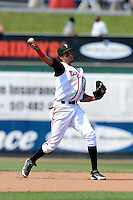 Lansing Lugnuts shortstop Emilio Guerrero (13) during a game against the Dayton Dragons on August 25, 2013 at Cooley Law School Stadium in Lansing, Michigan.  Dayton defeated Lansing 5-4 in 11 innings.  (Mike Janes/Four Seam Images)