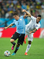 Cristian Rodriguez of Uruguay and Raheem Sterling of England