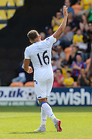 Dwight Gayle of Crystal Palace acknowledges the travelling supporters after scoring his third goal against Barnet to make it 1-3 during the Friendly match between Barnet and Crystal Palace at The Hive, London, England on 11 July 2015. Photo by David Horn.