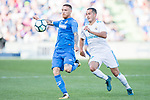 Amath Ndiaye Diedhiou of Getafe CF (L) fights for the ball with Lucas Vazquez Iglesias of Real Madrid (R) during the La Liga 2017-18 match between Getafe CF and Real Madrid at Coliseum Alfonso Perez on 14 October 2017 in Getafe, Spain. Photo by Diego Gonzalez / Power Sport Images