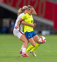 TOKYO, JAPAN - JULY 21: Lindsey Horan #9 of the USWNT defends Kosovare Asllani #9 of Sweden during a game between Sweden and USWNT at Tokyo Stadium on July 21, 2021 in Tokyo, Japan.